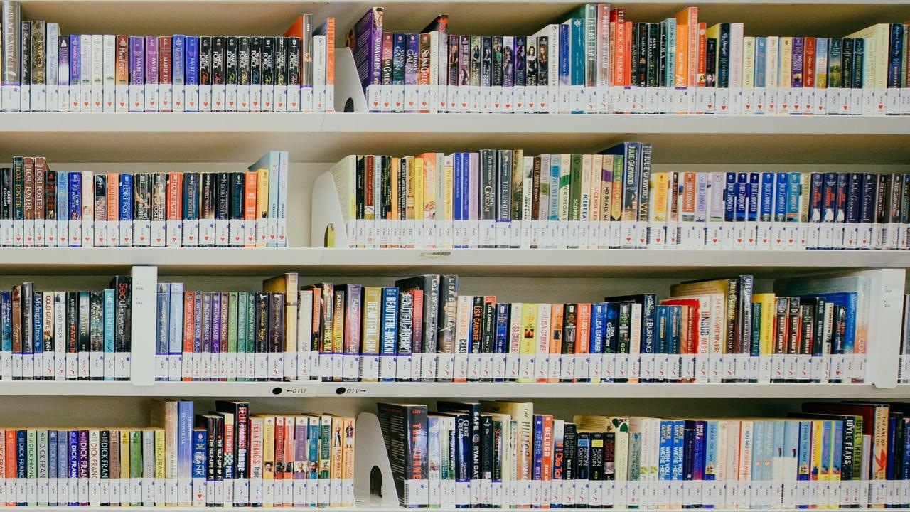 Ngyfwke2suimlhk3k8va library shelves 7 stories
