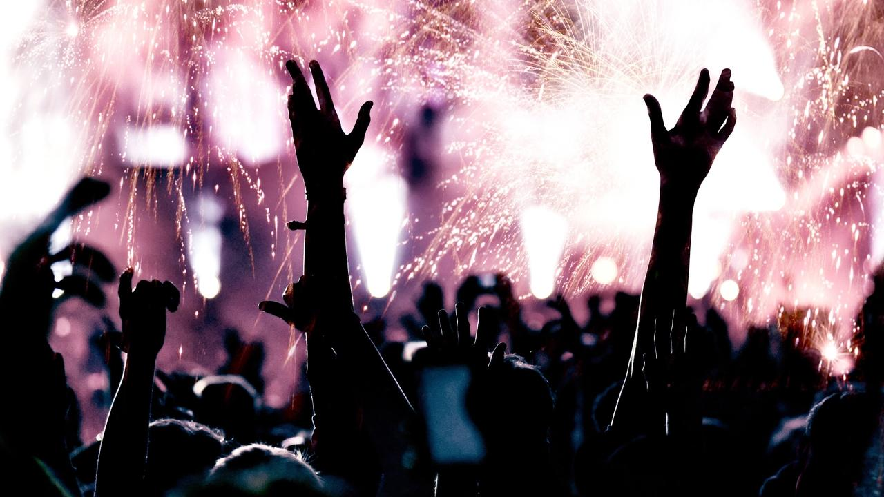 I38qipfztncoylvmgorn cheerful crowd and fireworks new year concept pvtql6m 1