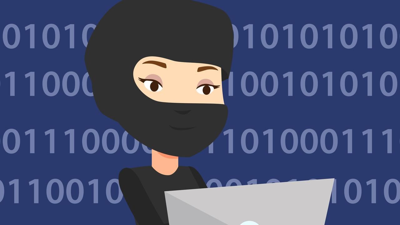 D7y4dwo8tbkcq0kgkh8n cybercrime computer hacker in mask working on a laptop binary code