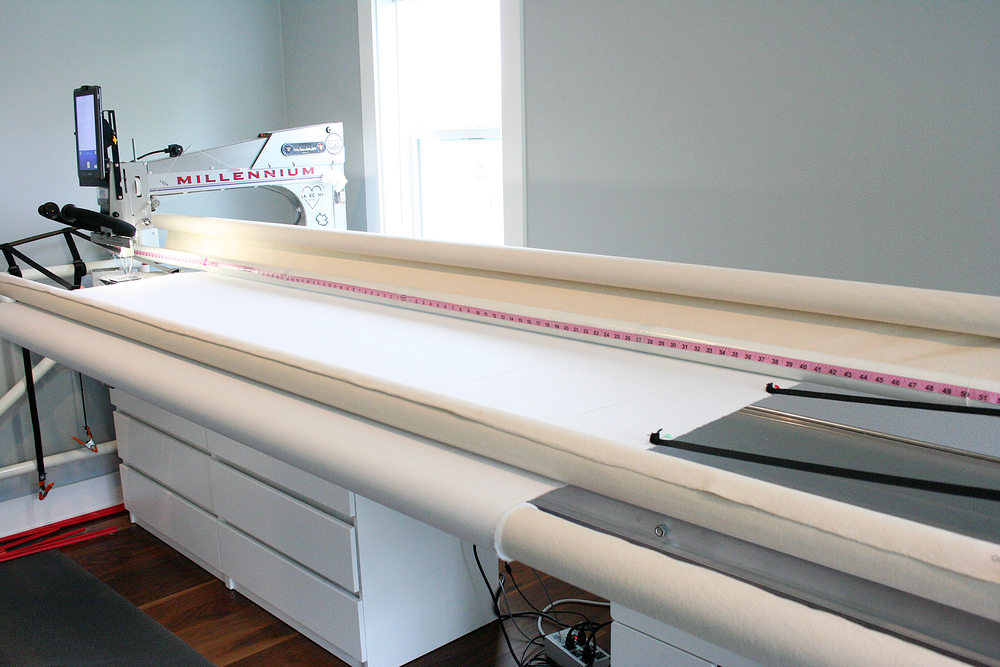loading a quilt backing ready with side elastics