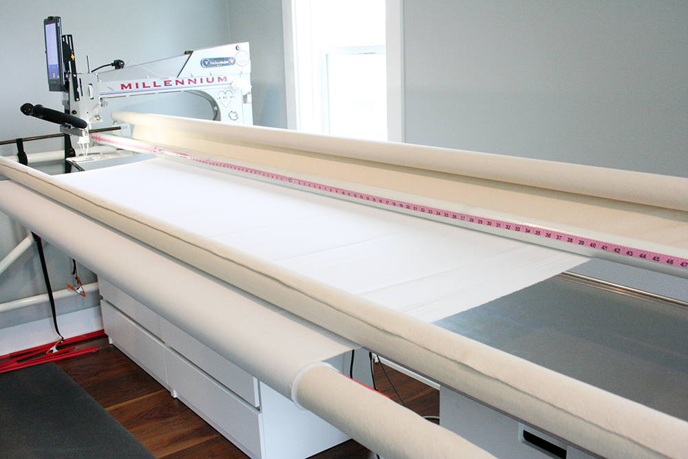 loading a quilt backing in position