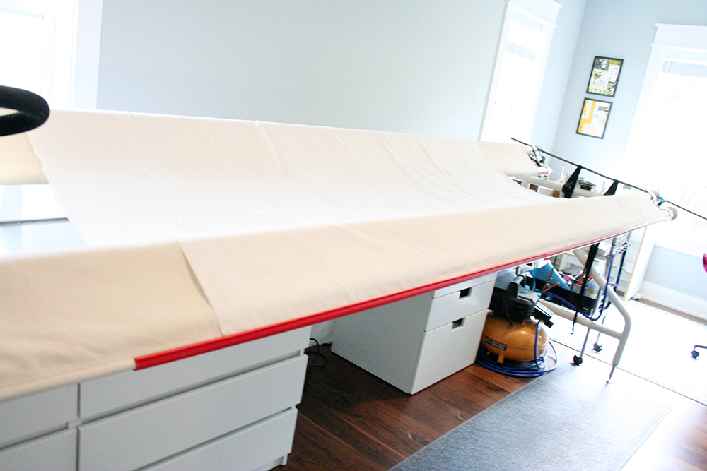 loading a quilt backing bottom edge secured with red snappers