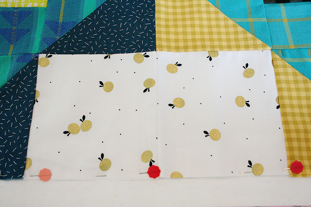 loading a quilt top pinning the top edge