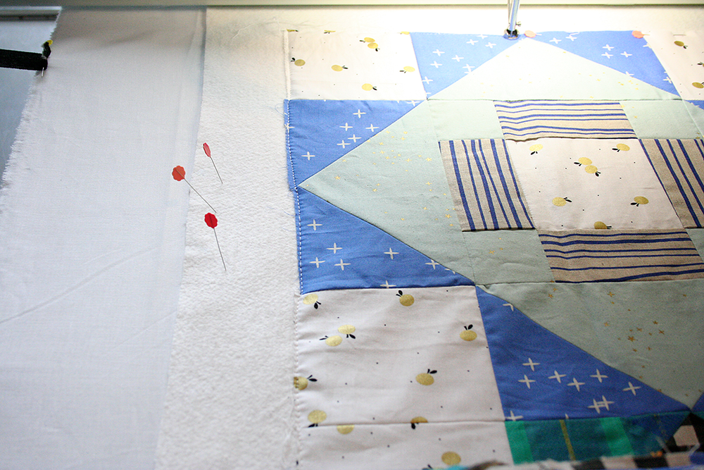 loading a quilt top basting close to the edge