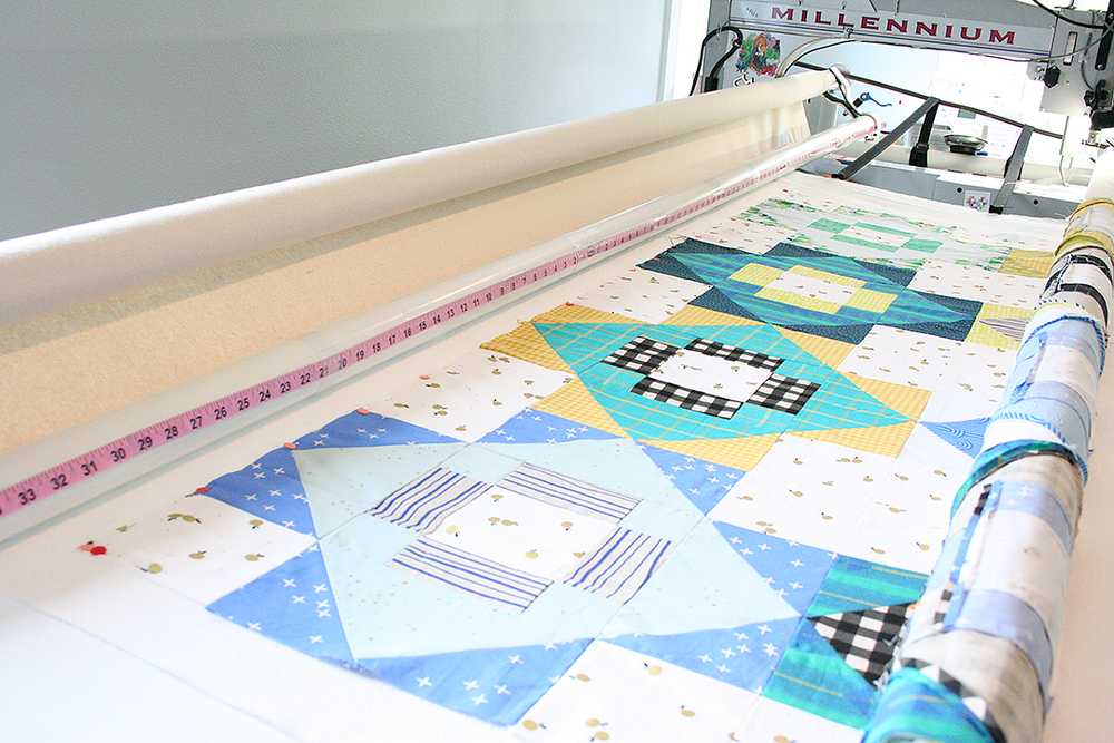 loading a quilt top ready for basting around the edges