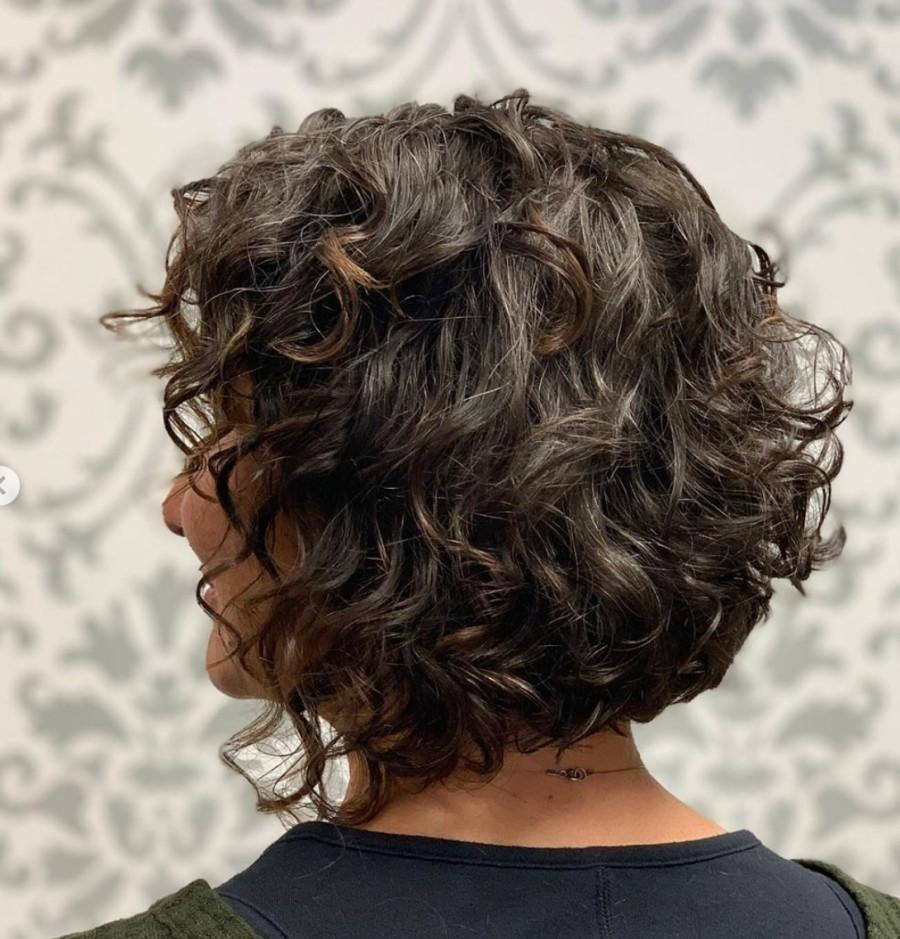 Gorgeous curls on black woman with transitional gray coloring