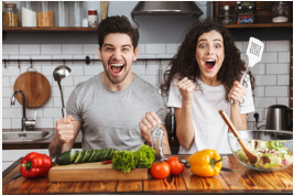 vegan man and woman excited to eat vegetables in their kitchen