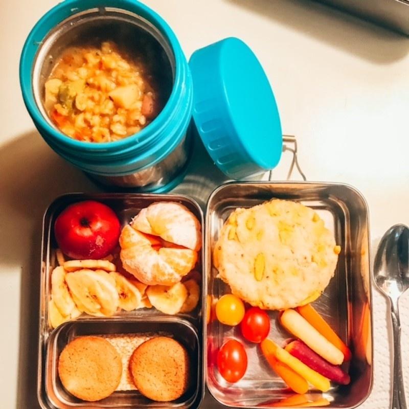Your Vegan Family Vegan Kids lunch/ lentil vegetable soup, savory scone, baby carrots, bursting tomatoes, mandarine, plum, dried bananas, ginger cookies, sesame seed bar