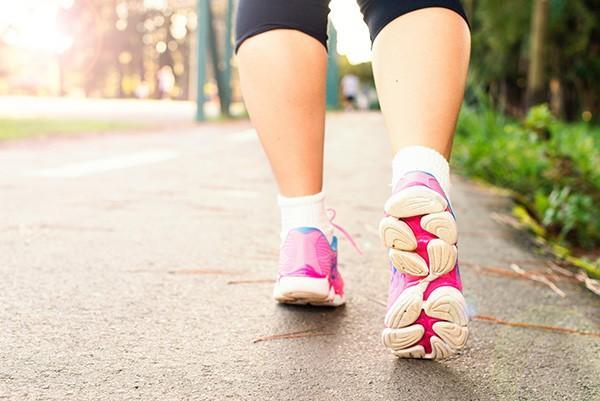 woman wearing pink walking shoes