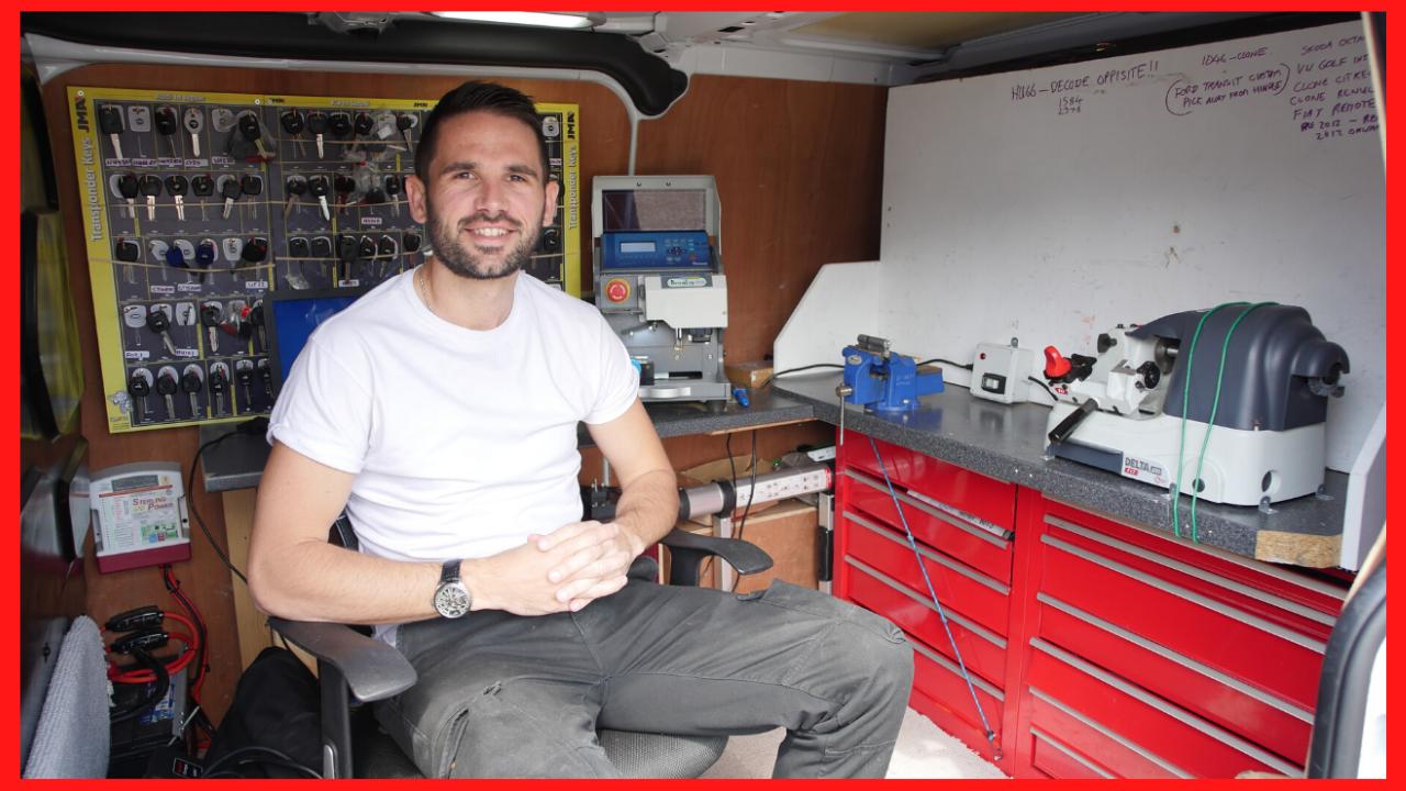 an online locksmith trainer sitting in a locksmith van