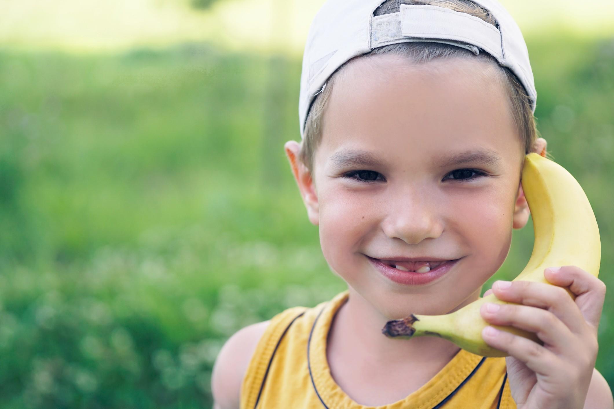 boy using banana as a telephone
