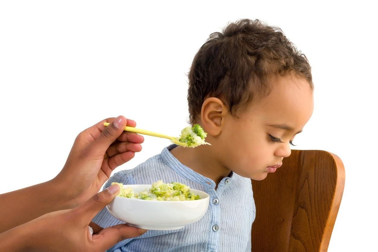 picky eater boy refusing to eat vegetables