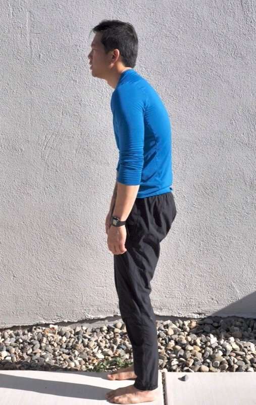 man with hunchback posture
