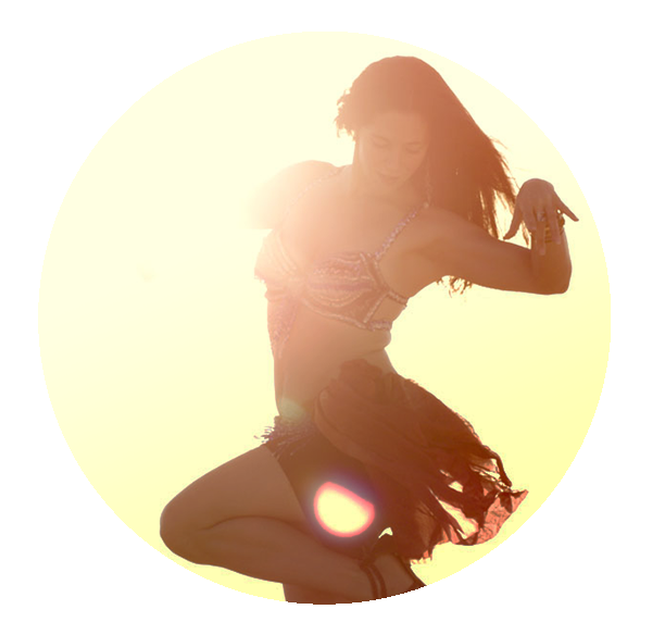 Jada dances at sunset in a bellydancer outfit