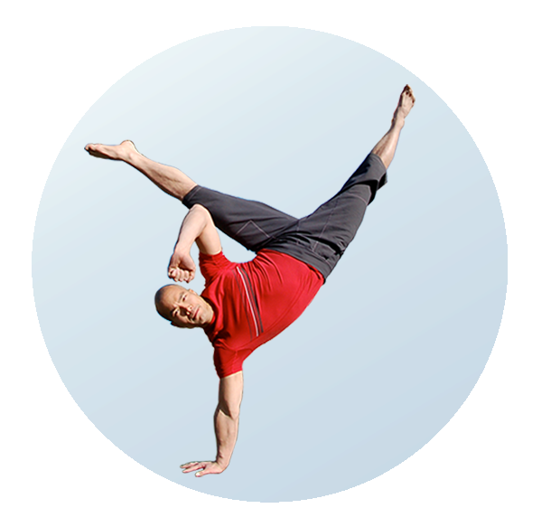Alvin Tam in one-handed handstand with his legs in a straddle on white background
