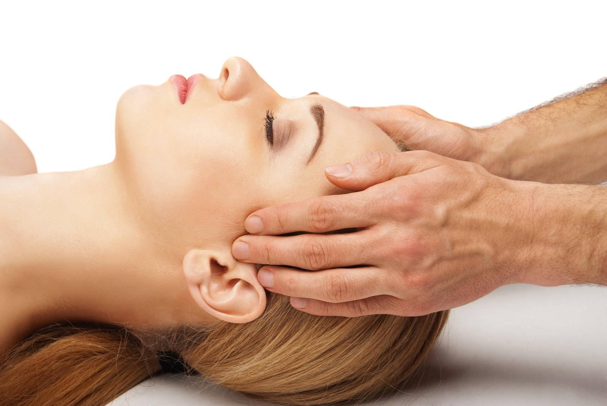 Frau bei manueller Kiefergelenk-Therapie