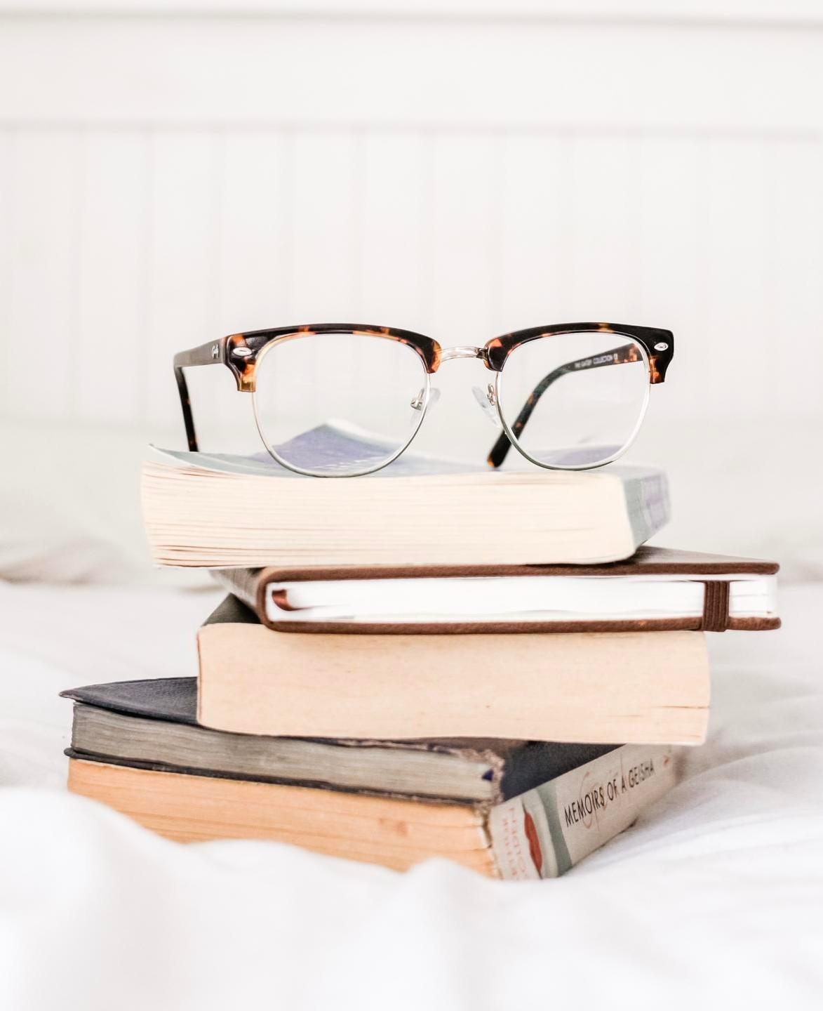photo of books and eyeglass