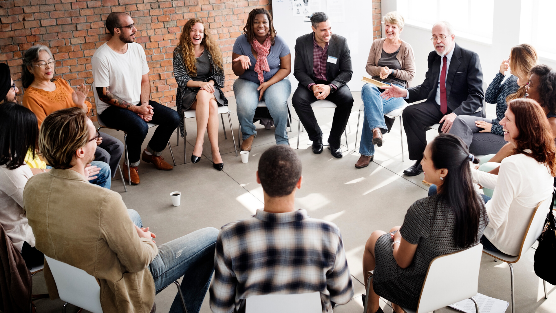 interactive team exercise of diverse people sitting in a circle