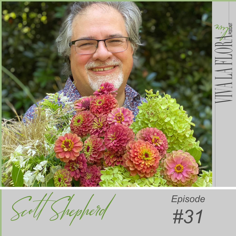 GUY SMILING HOLDING FLOWERS