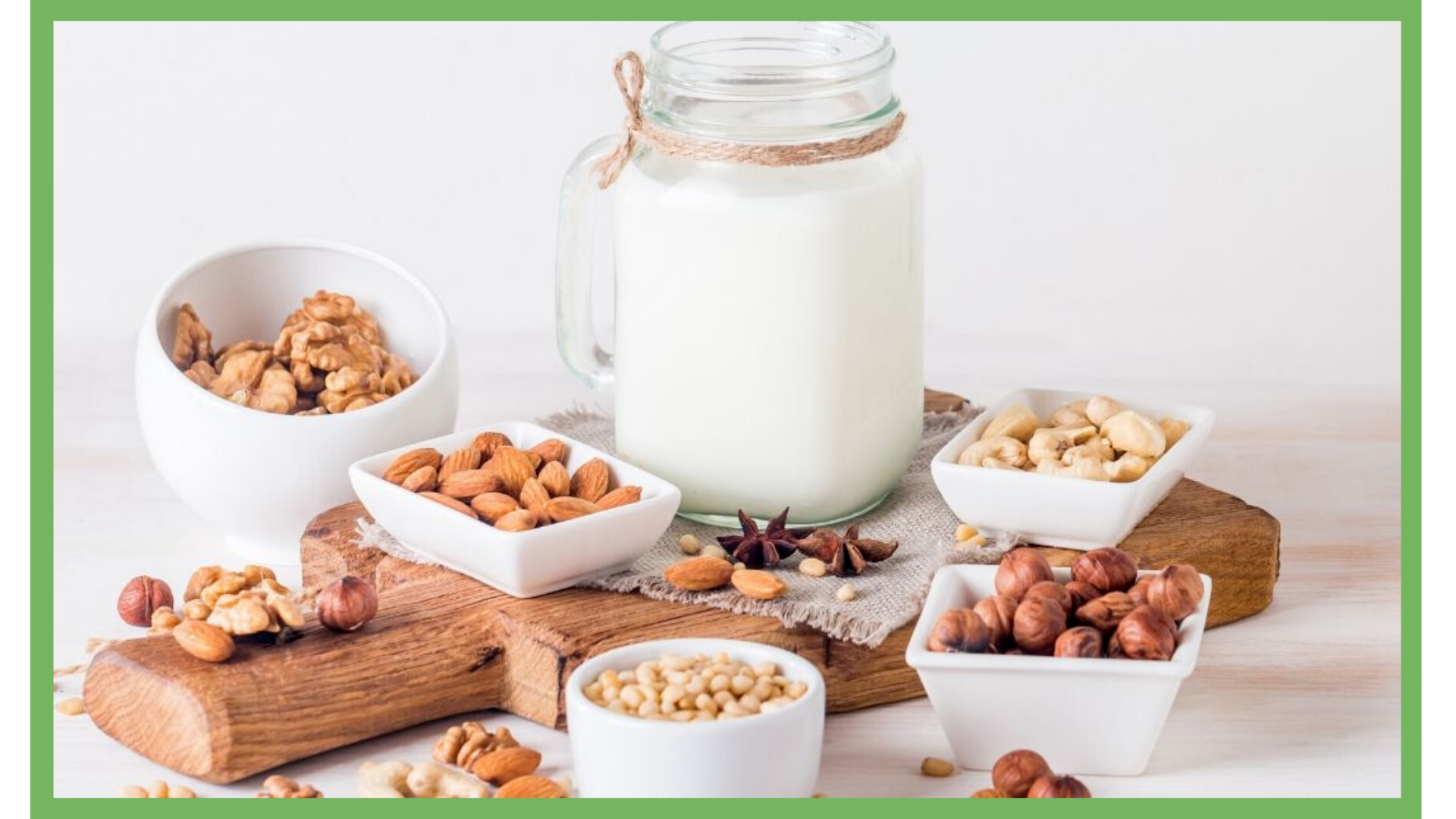 Jar of nutmilk and bowls of nuts