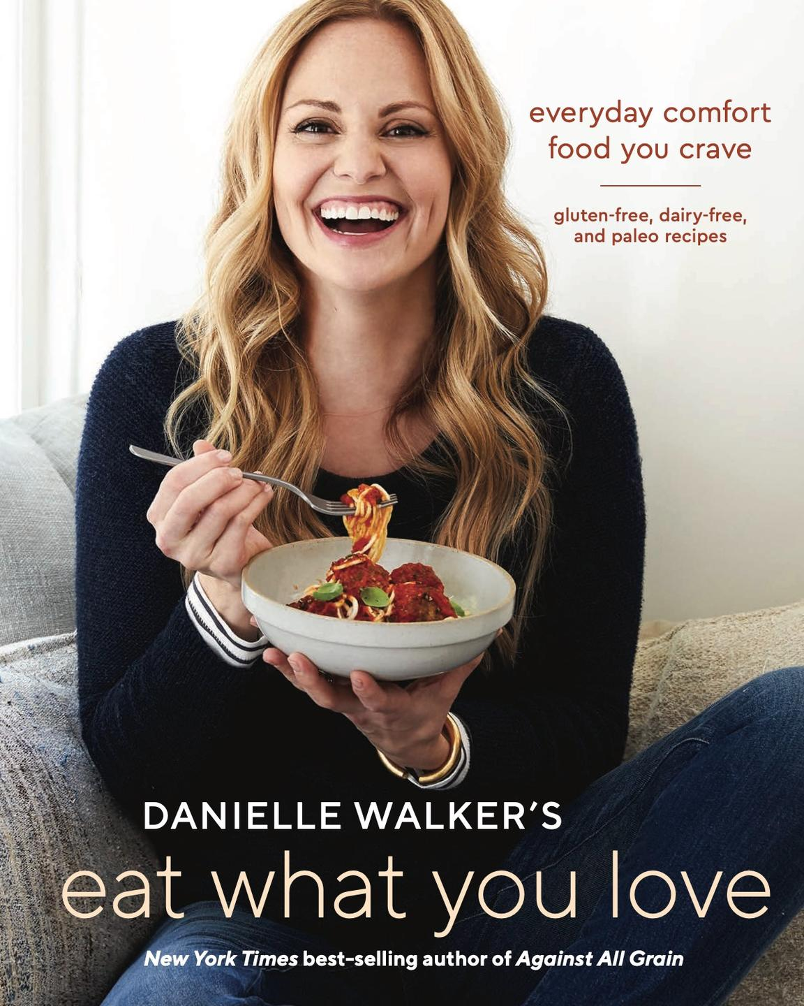 eat what you love cover showing danielle walker eating a bowl of gluten free spaghetti