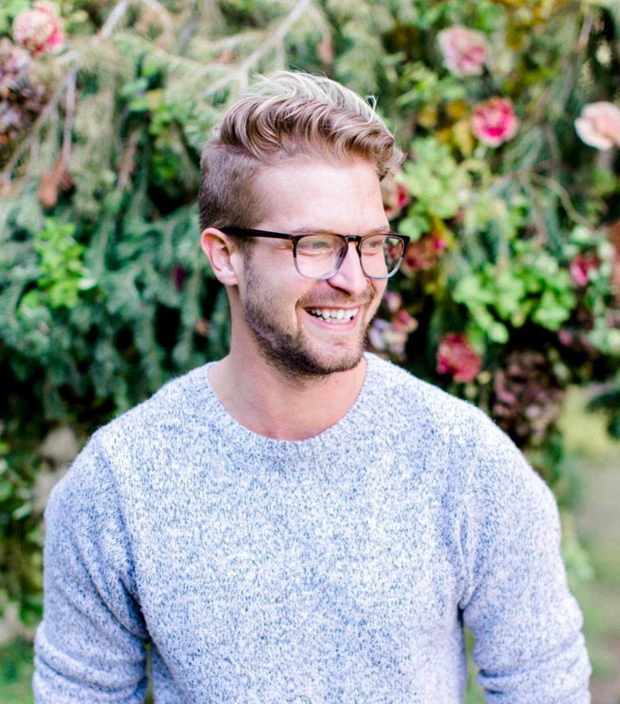 Man smiling wearing gray top and glasses Viva La Flora Live Podcast