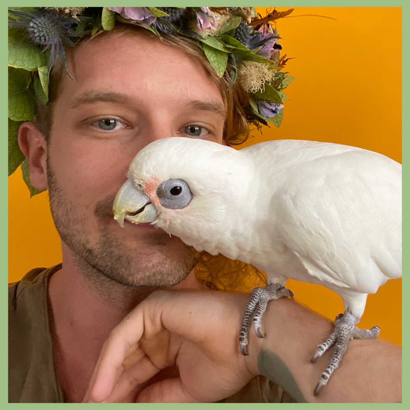 Guy holding a white bird and wearing a floral crown Viva La Flora Live Podcast