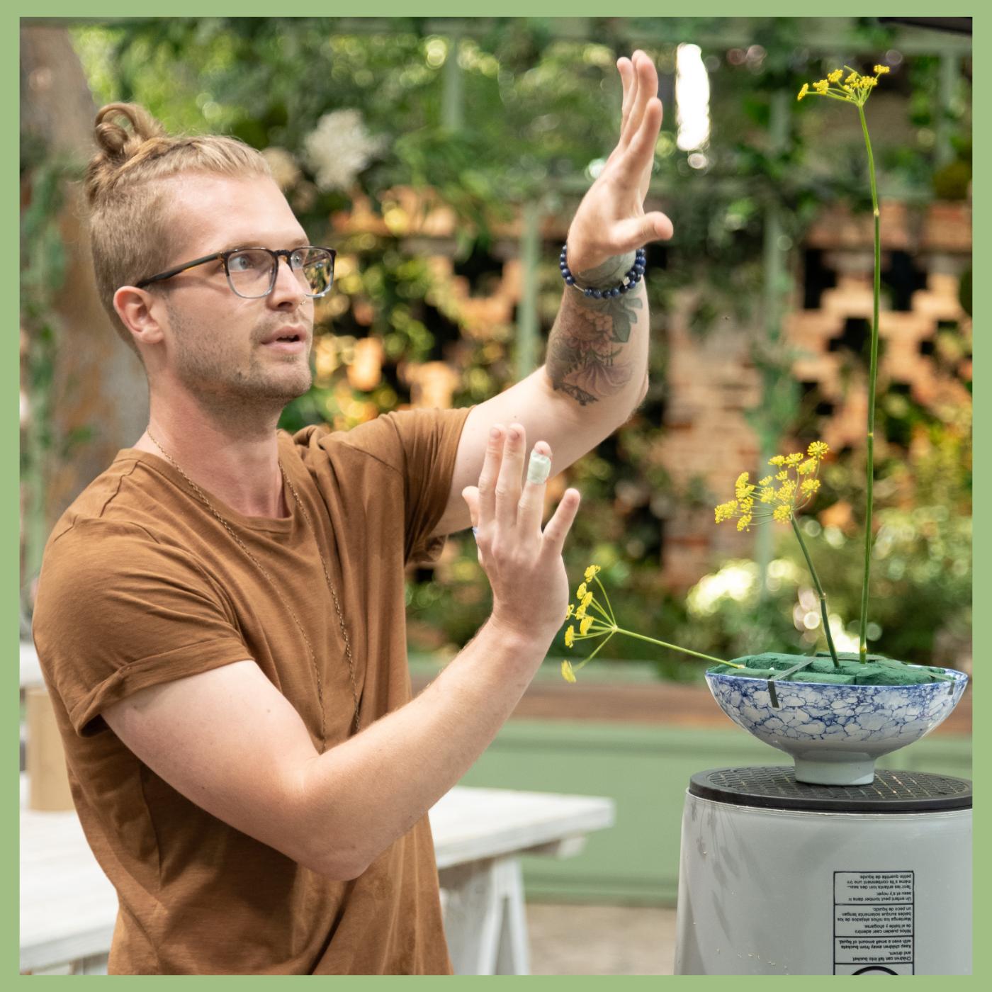 Guy arranging flowers during HBO Max Full Bloom tv competition Viva La Flora Live Podcast