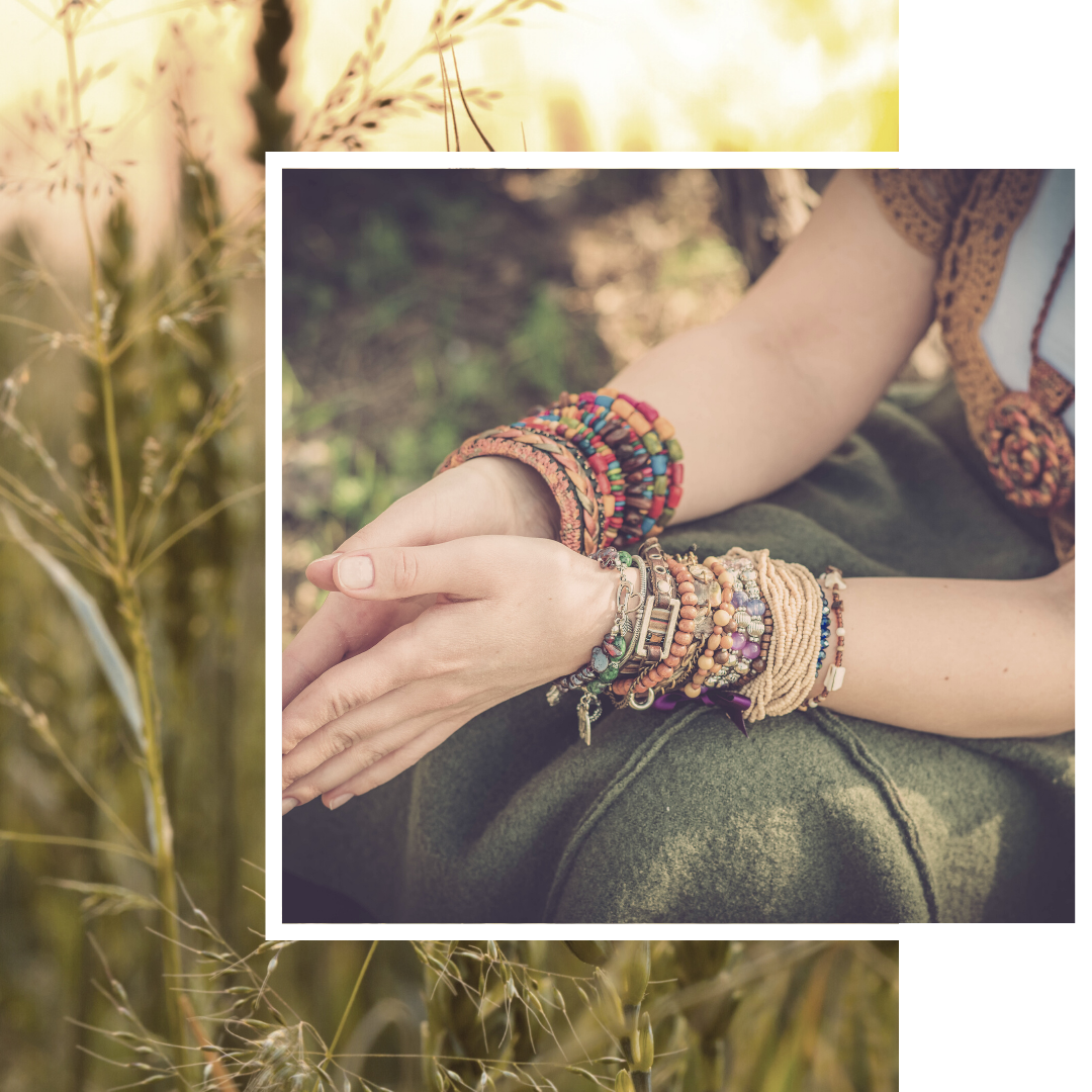 photo of woman's hands with multi-colored bracelets