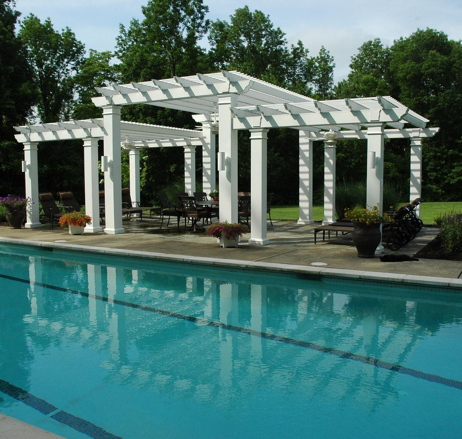 Custom vinyl pergola by pool with square, Tuscan columns