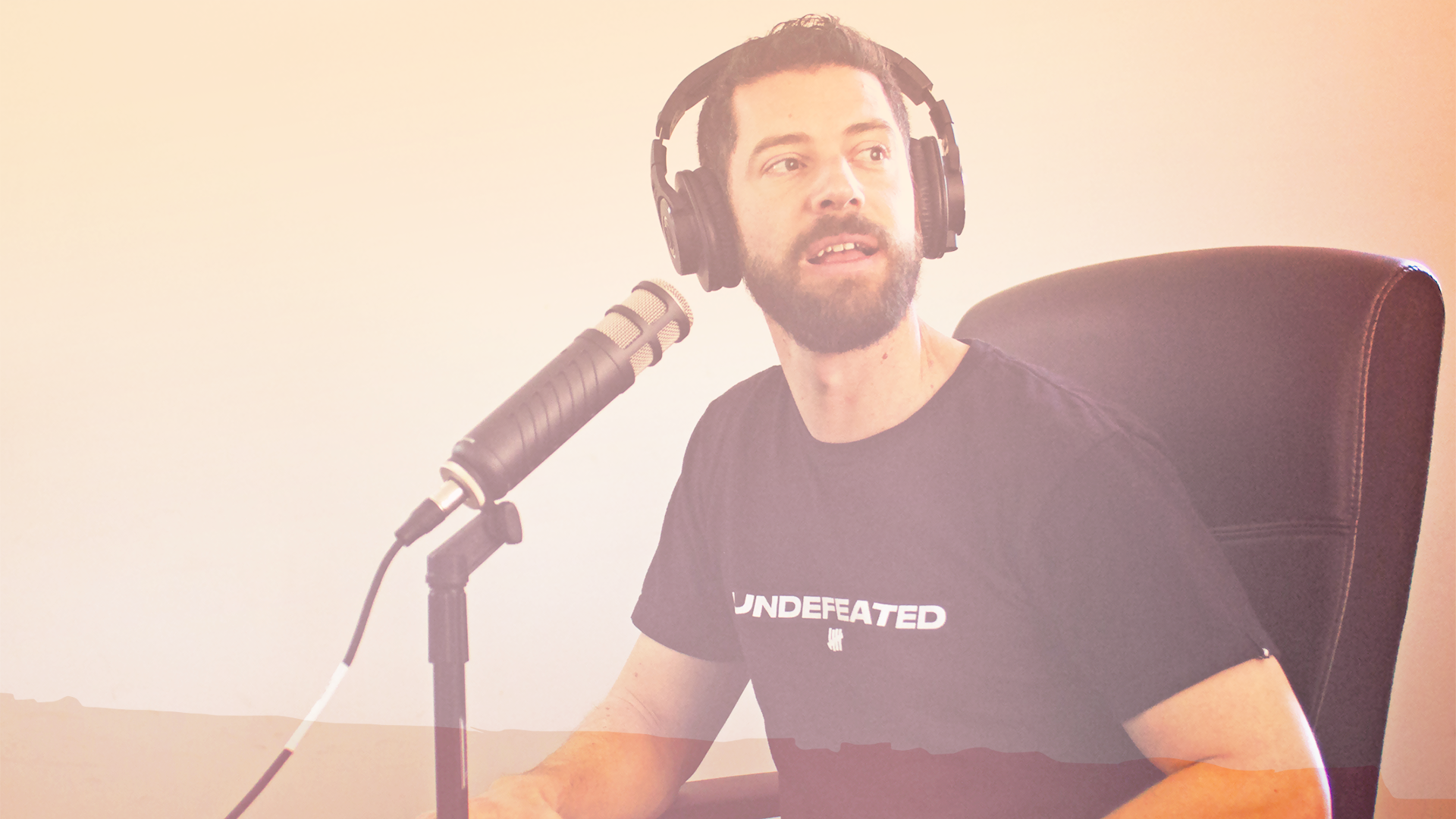 Mike hosting a podcast live recording