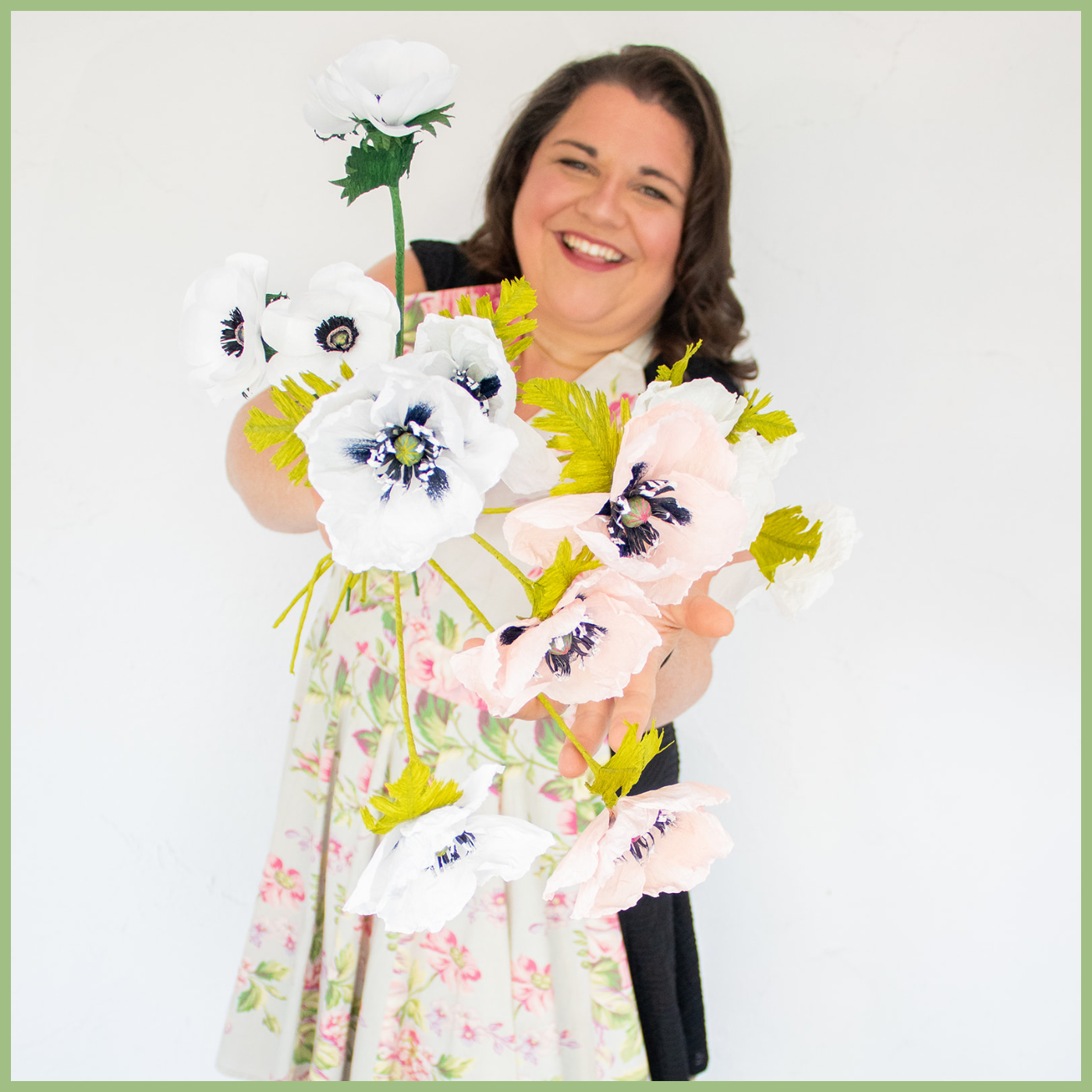 woman wearing a colorful floral apron and holding poppy flower bouquet Viva La Flora Live Podcast