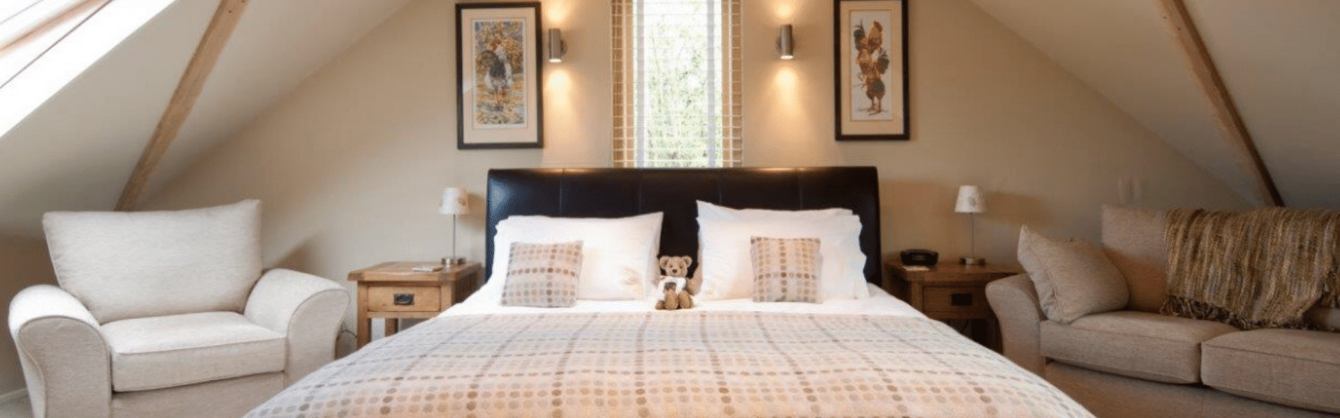 Leather bed with neutral spotted welsh blanket, white bed lined and teddy bear