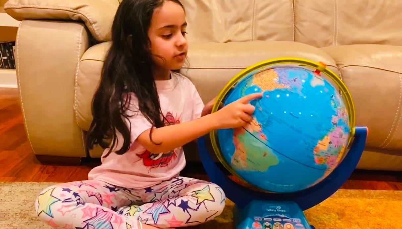 Shyla teaching children about the world