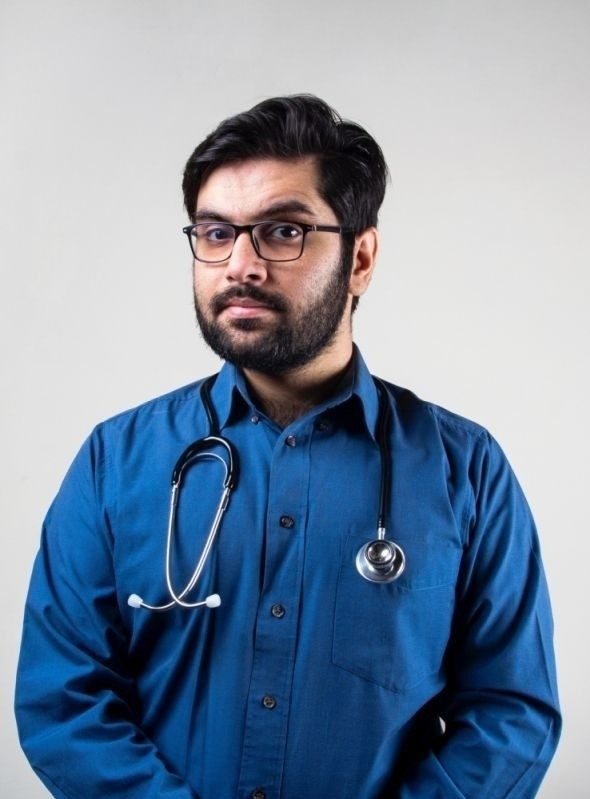 male doctor in blue shirt and stethoscope