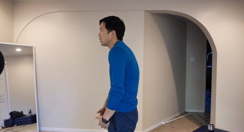matt hunchback in blue sweater