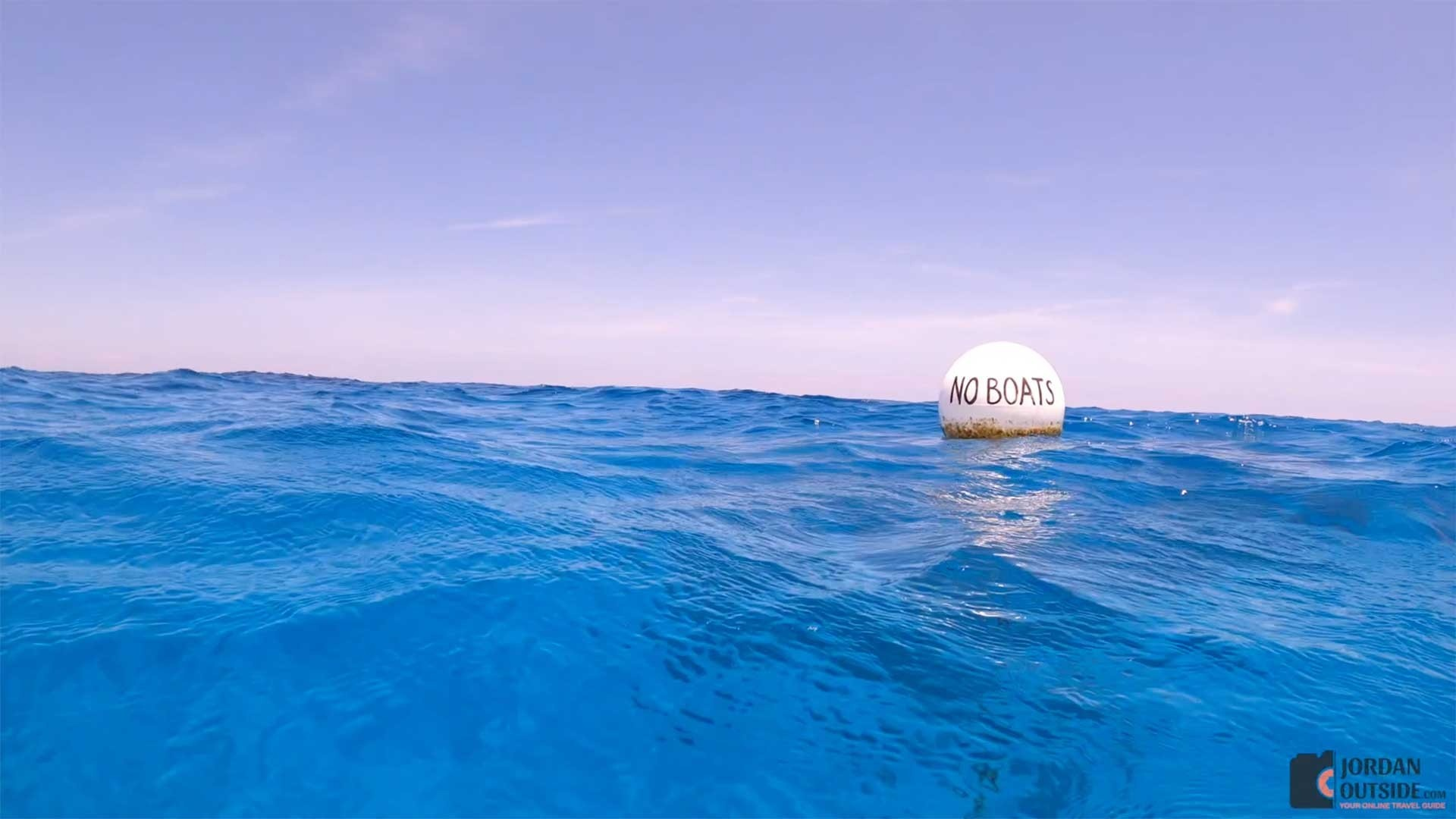 The white buoy that says No Boats