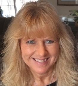 happy blonde woman in office