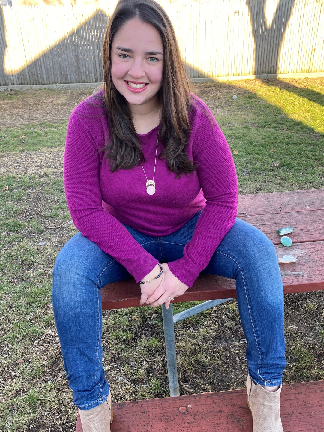 girl sitting on picnic table