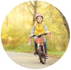 Happy child riding a bicycle