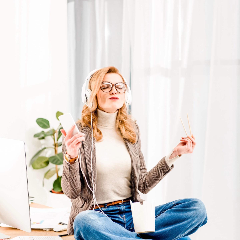 Photo of Happy Woman Listening to Headphone