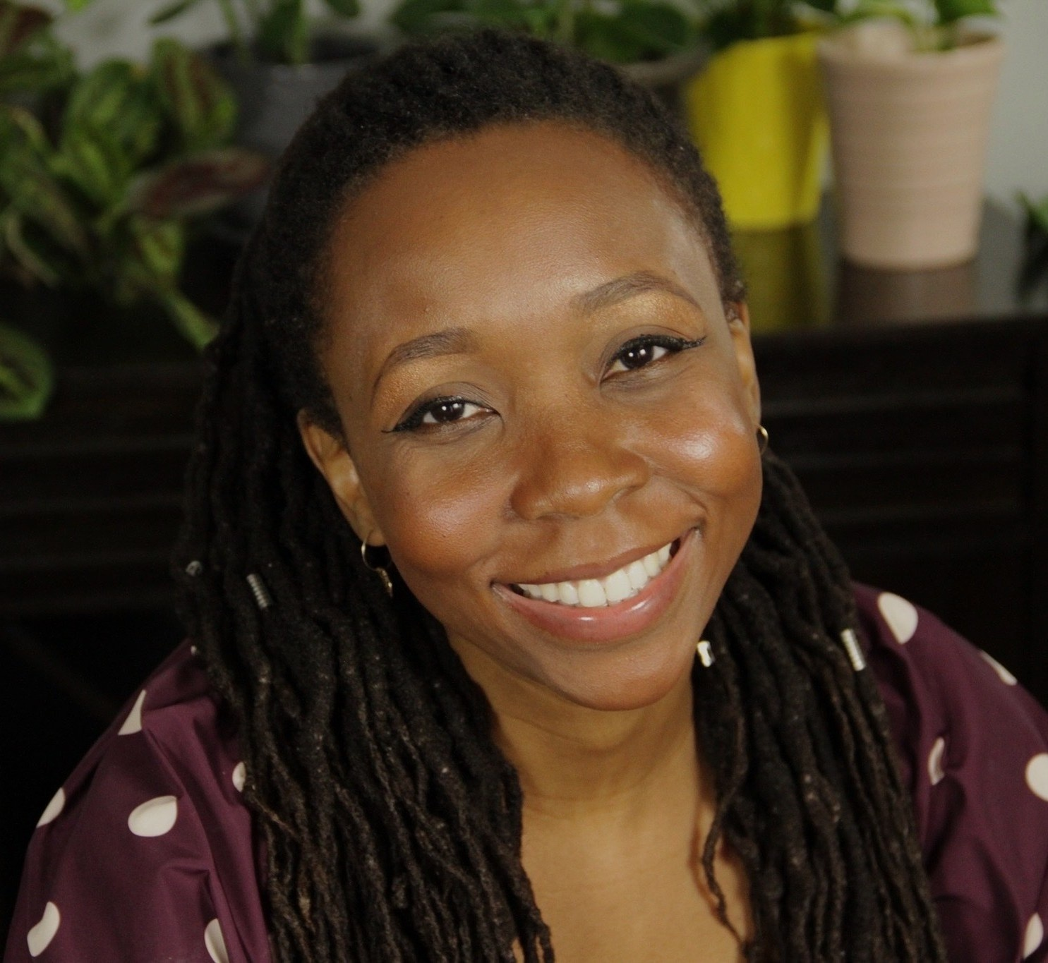 Image of saran, menstrual health educator, smiling.