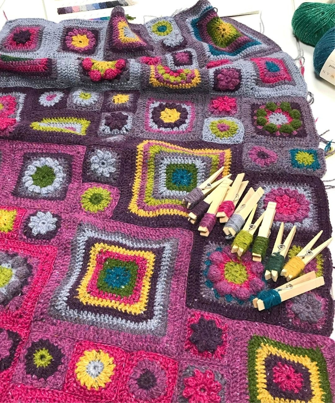 Granny Square crochet blanket and yarns