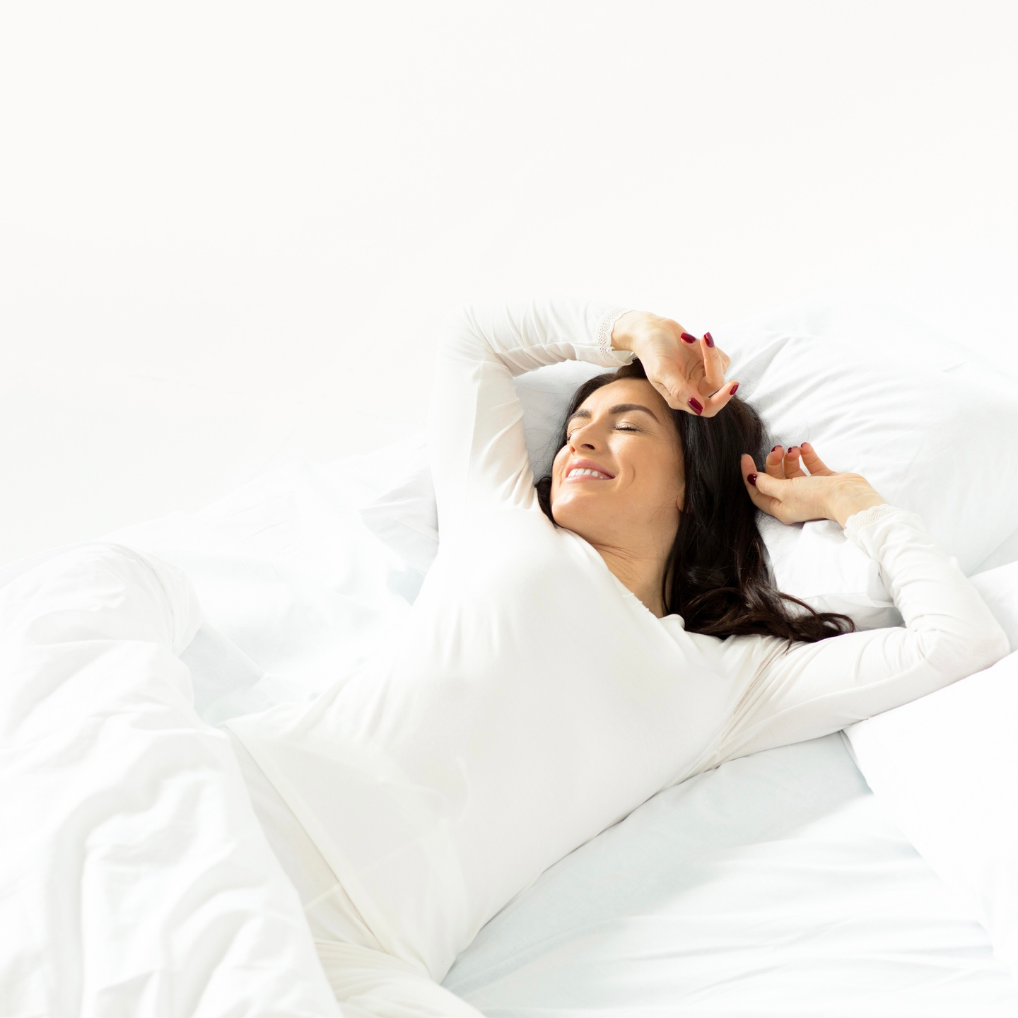 Photo of Woman Smiling In Bed