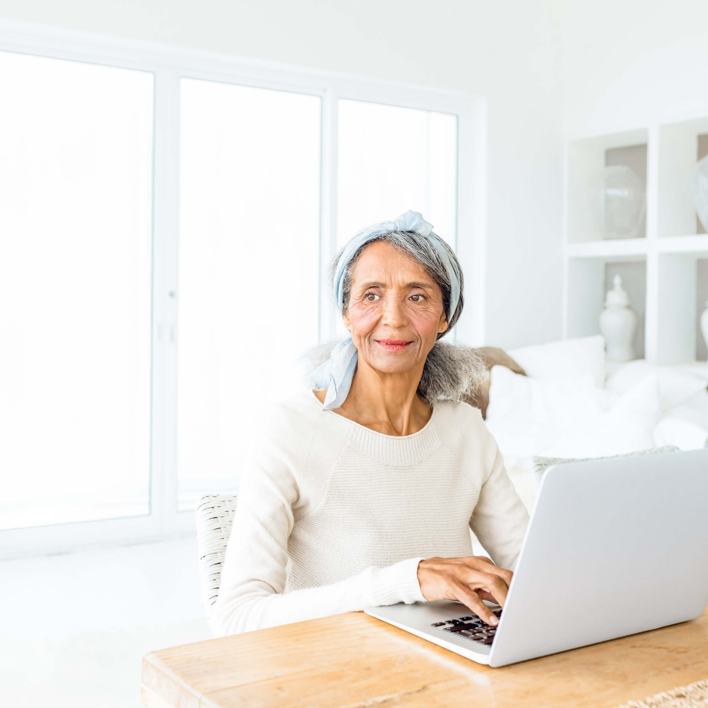 Photo of Woman Smiling at Laptop