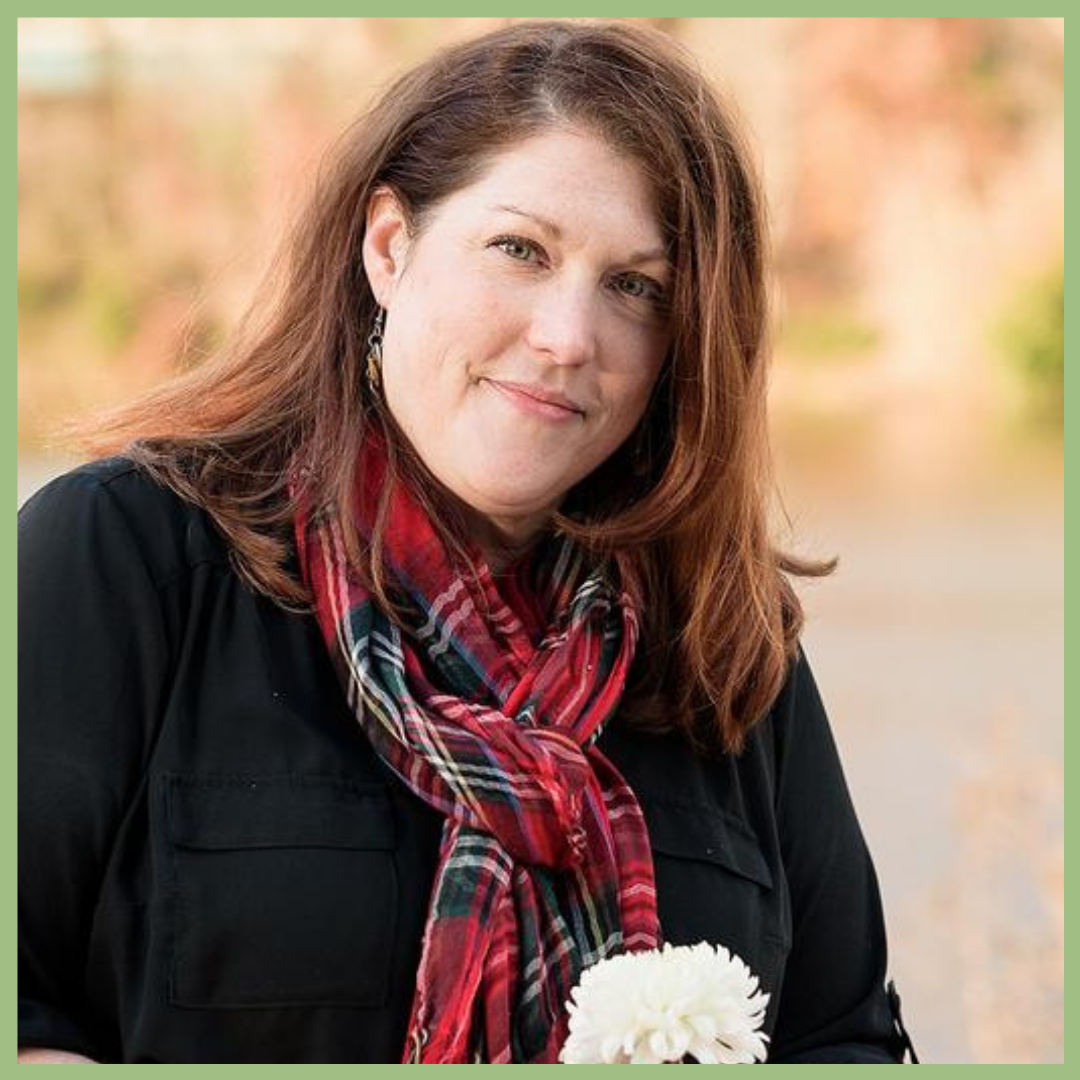woman smiling wearing a red scurf and holding a flower in the fall , Christi Lopez floral designer and educator for Viva La Flora Live Podcast
