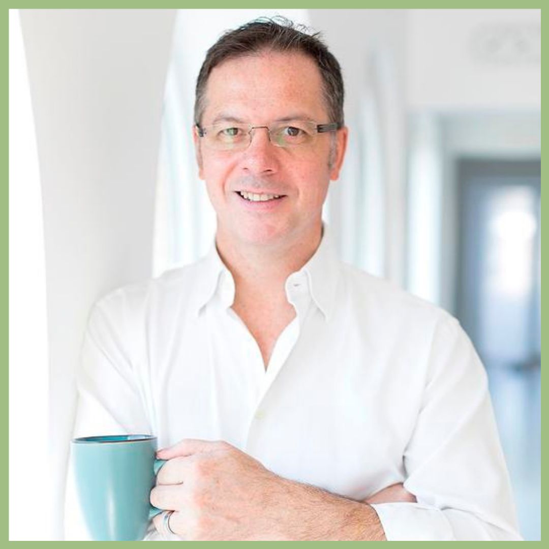 man with glasses standing holding a blue coffee cup and smiling , Tomas De Bruyne floral designer for Viva La Flora Live Podcast