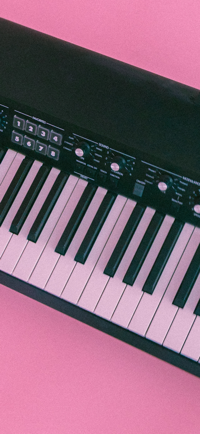 phone wallpaper of a piano keyboard on a pink background