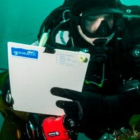 Diver recording info underwater