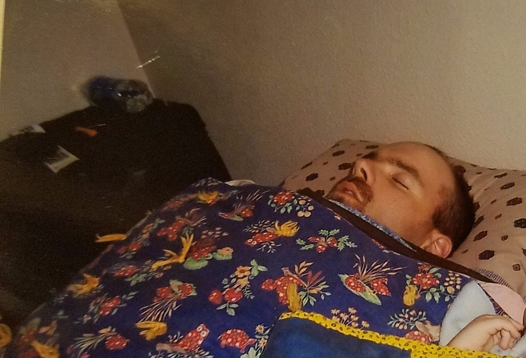 man laying in bed sick
